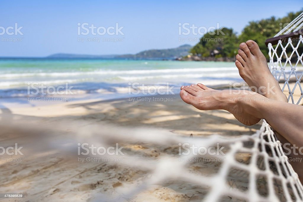 feet in hammock stock photo