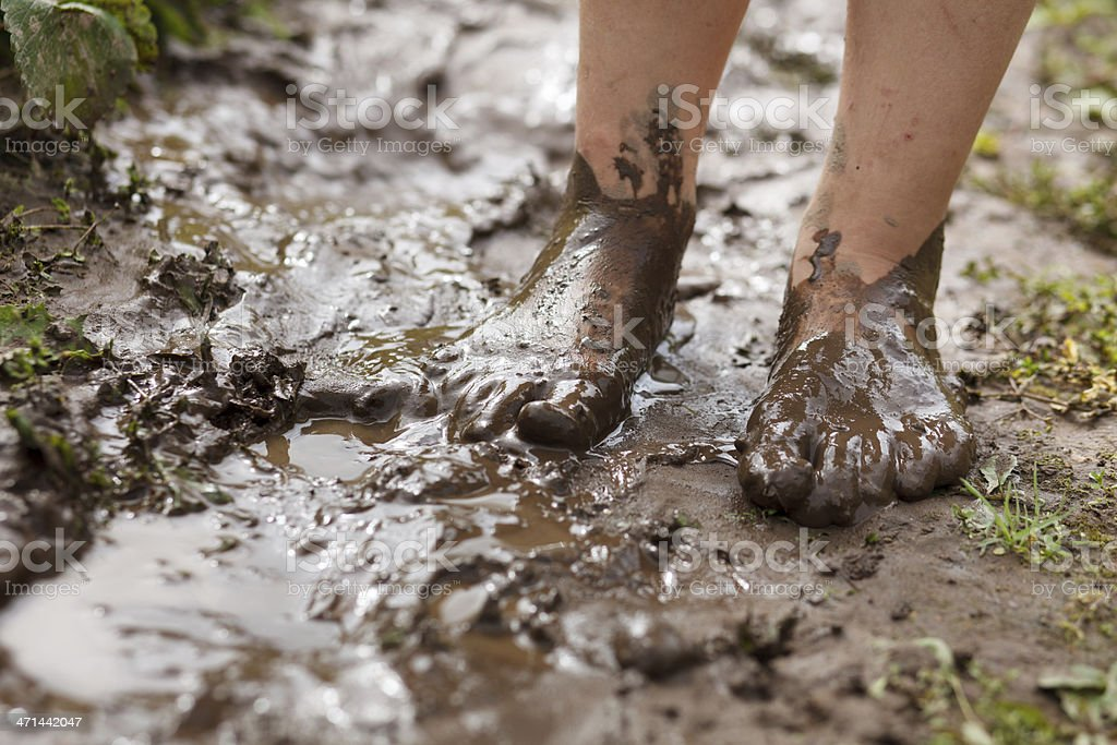 Feet in mud royalty-free stock photo