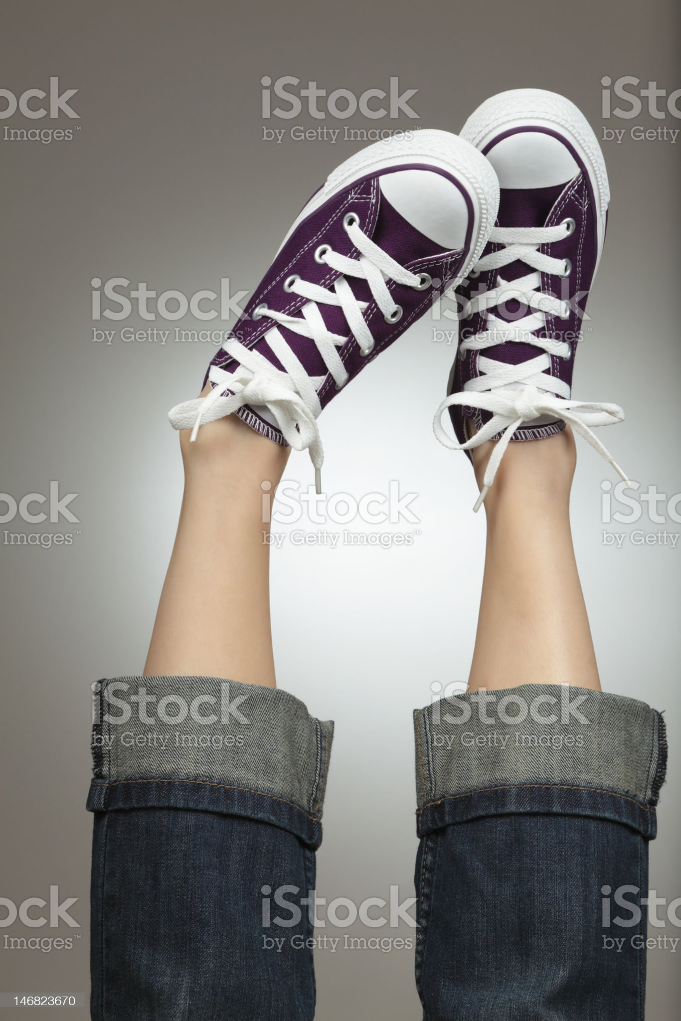 Feet in The Air With New Canvas Shoes royalty-free stock photo