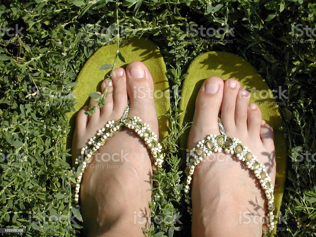feet in the green grass royalty-free stock photo