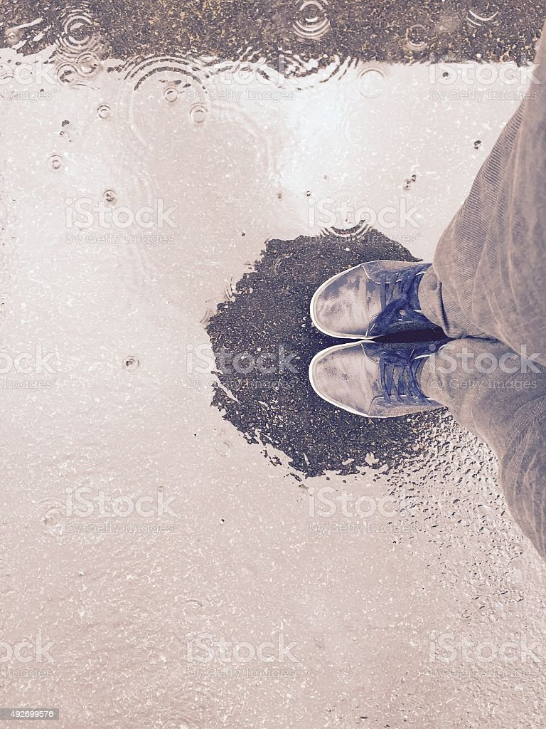 Feet in the rain stock photo