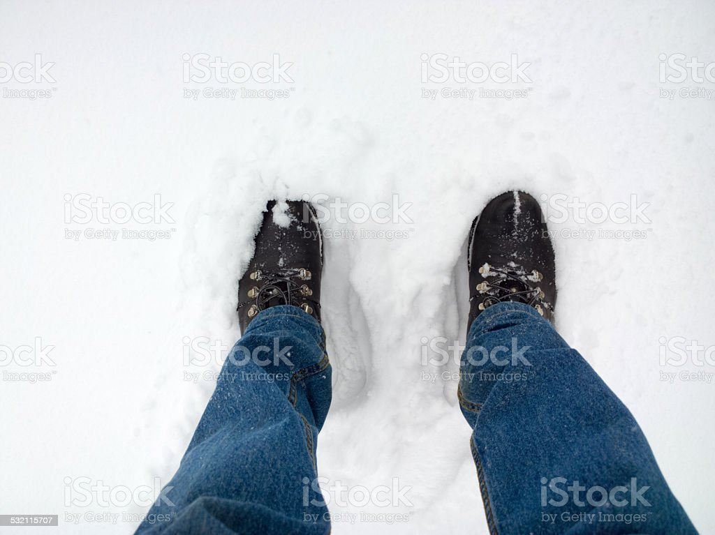 Feet in the snow. stock photo