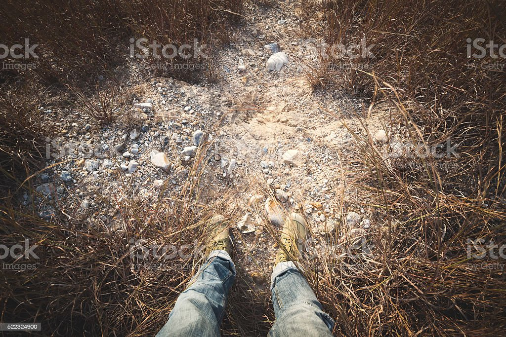 feet man in shoes on ground rock stock photo