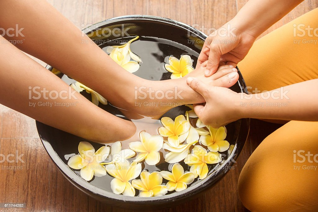 Feet massage in spa salon stock photo