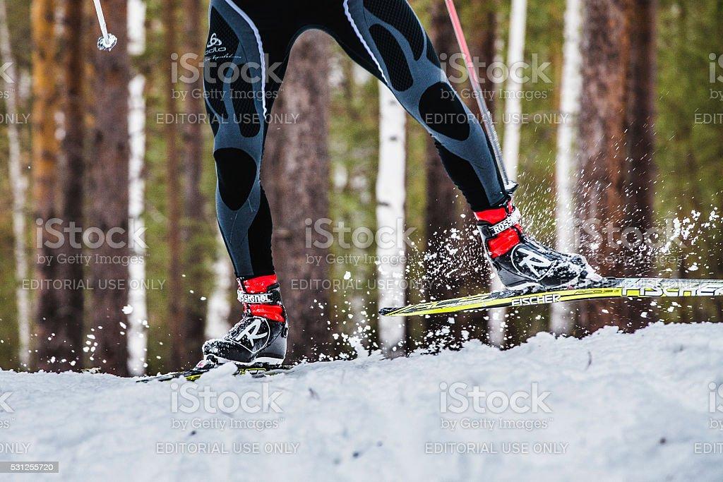 feet men skier sprays snow from under ski stock photo