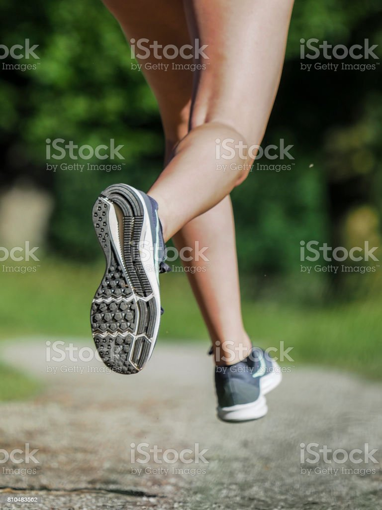 feet of a female jogger stock photo