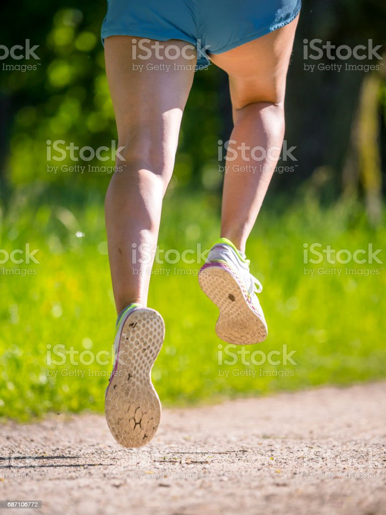 feet of a female runner stock photo