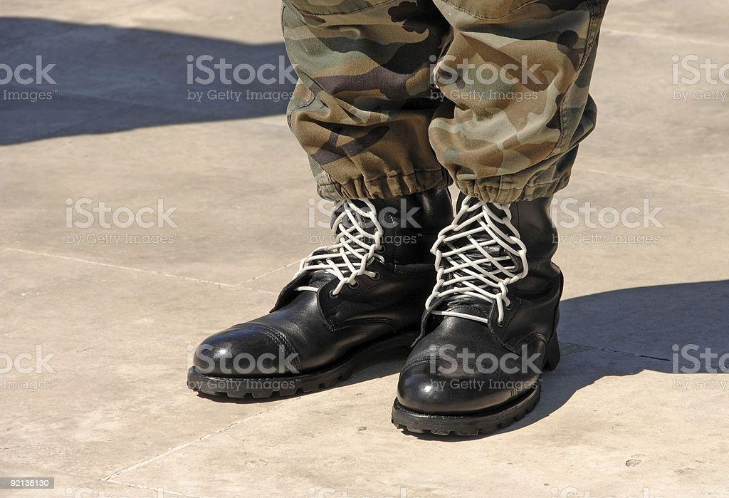 Feet of camouflaged soldier royalty-free stock photo