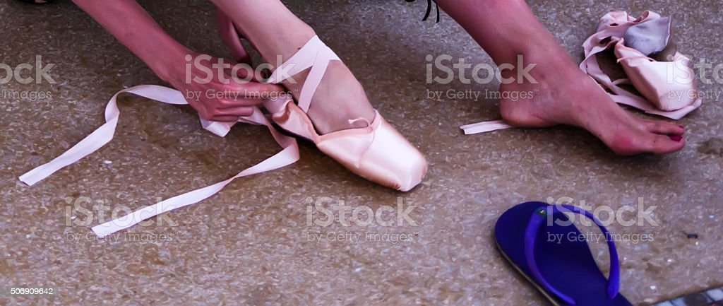 Feet of classical ballet dancer stock photo