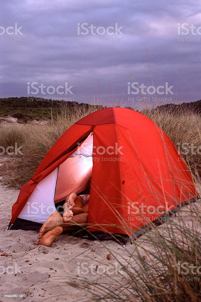 Feet of couple in tent stock photo