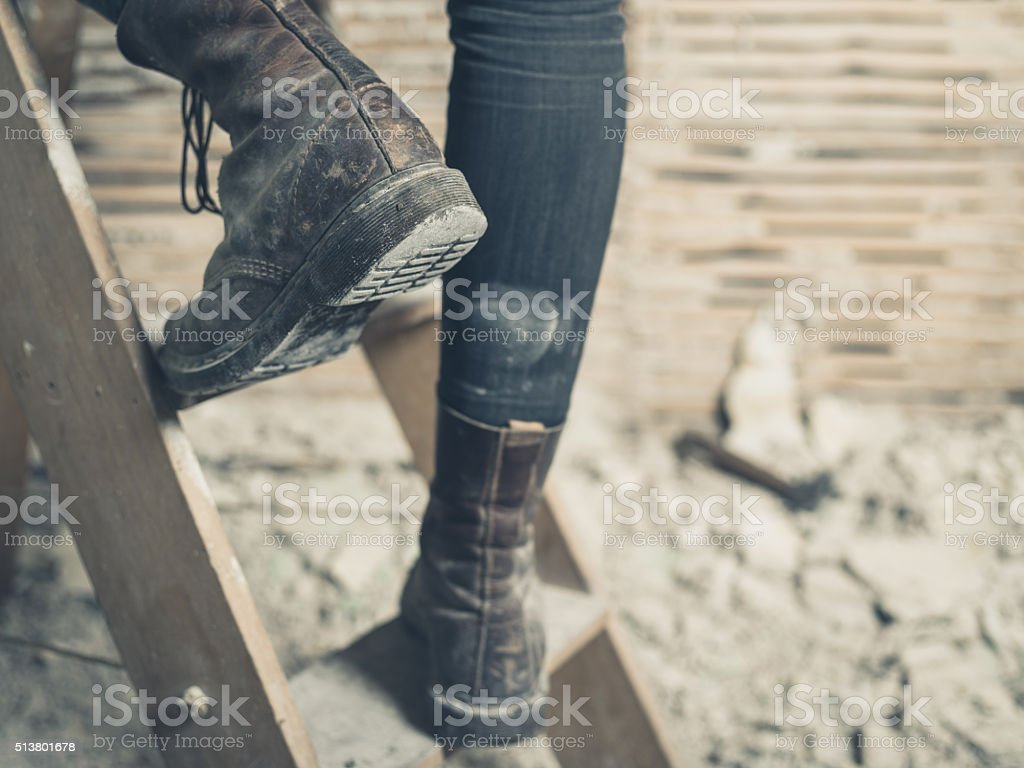 Feet of person on stepladder stock photo