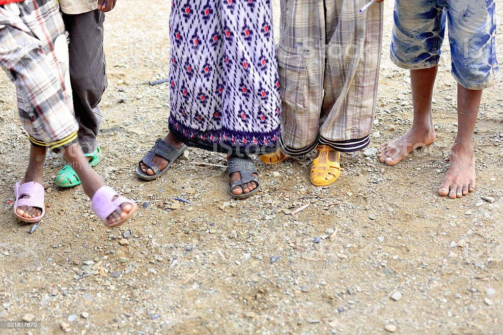 Feet of schoolboys on the playground. School at Berahile-Ethiopia. 0386 stock photo