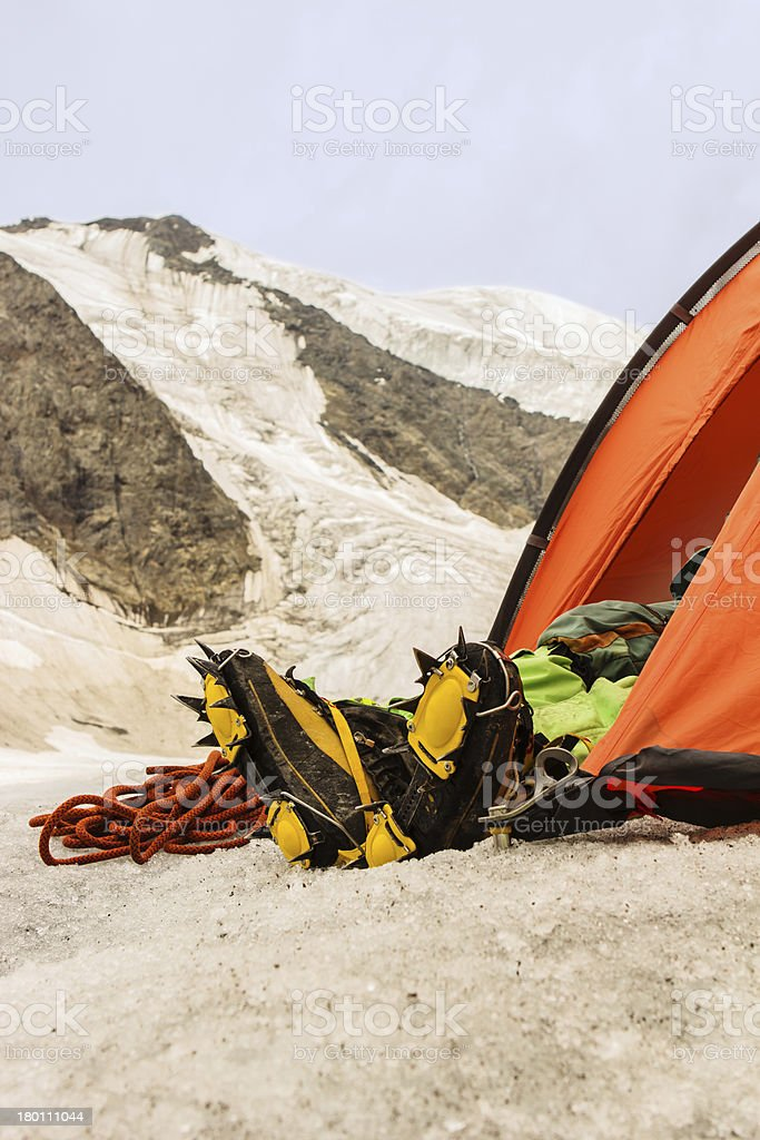 Feet of the climber in crampons stock photo