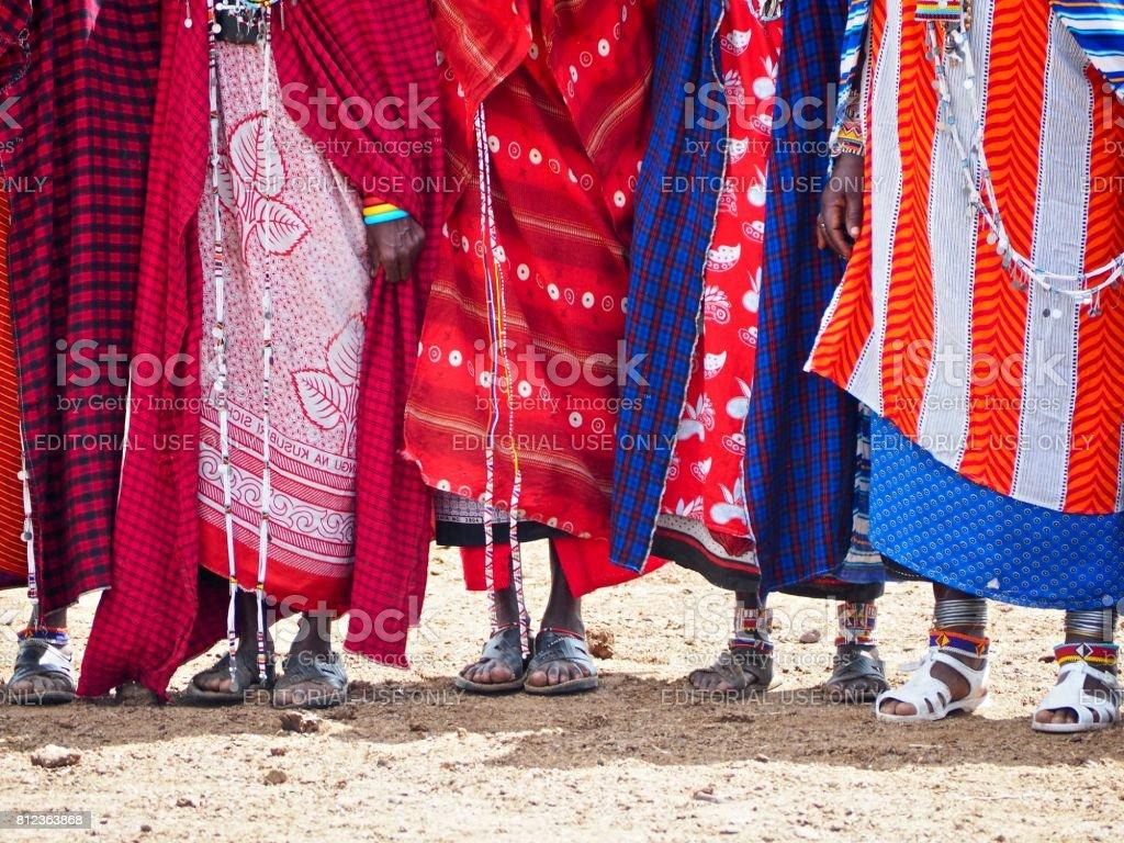 Feet of the Masai women in traditional dress in Amboseli, Kenya stock photo