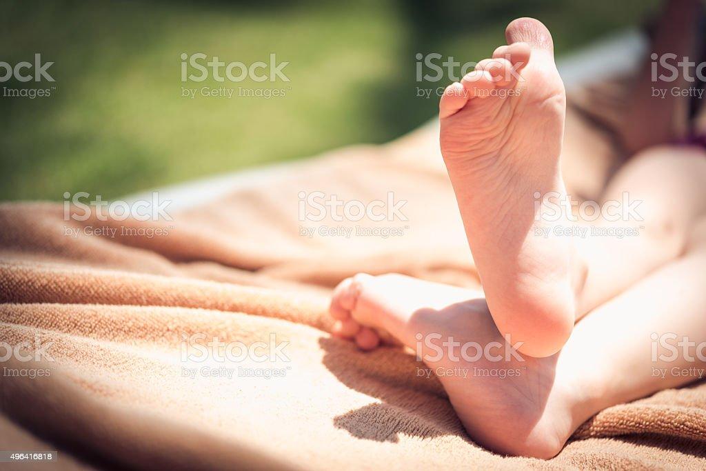 Feet of toddler on beach stock photo