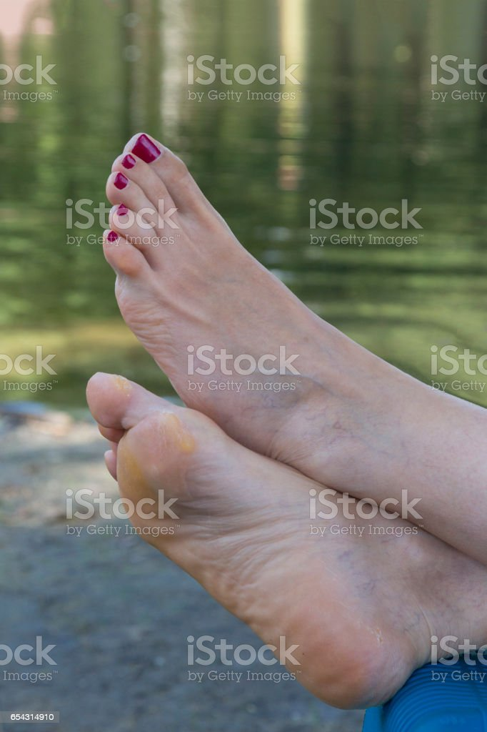 Feet of woman resting on the river stock photo