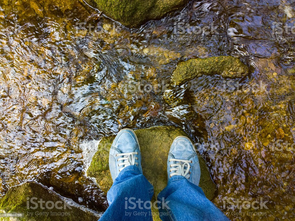Feet on a rock. stock photo