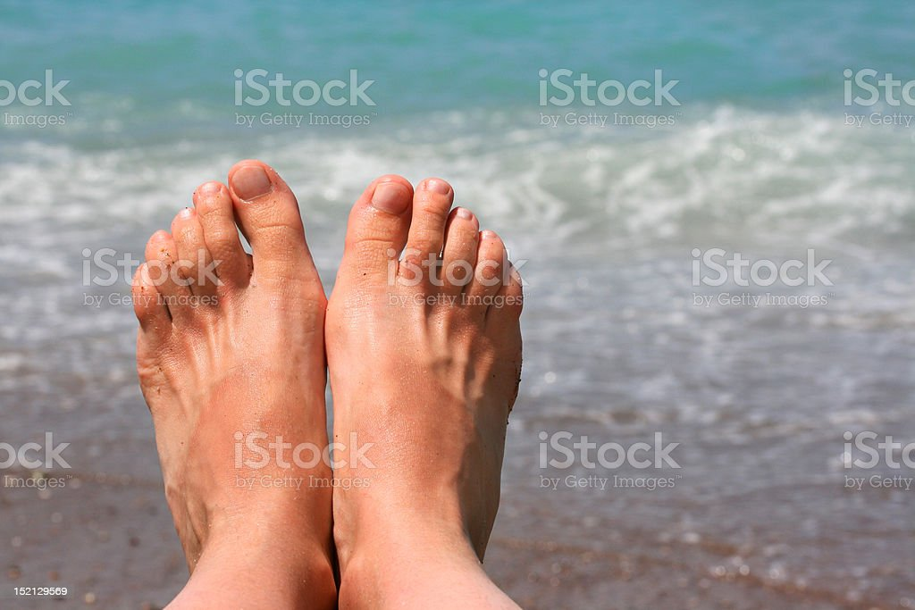 feet on a sea cost royalty-free stock photo