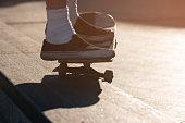 Feet on a skateboard.