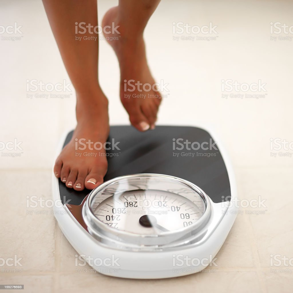 Feet on Bath Scale stock photo