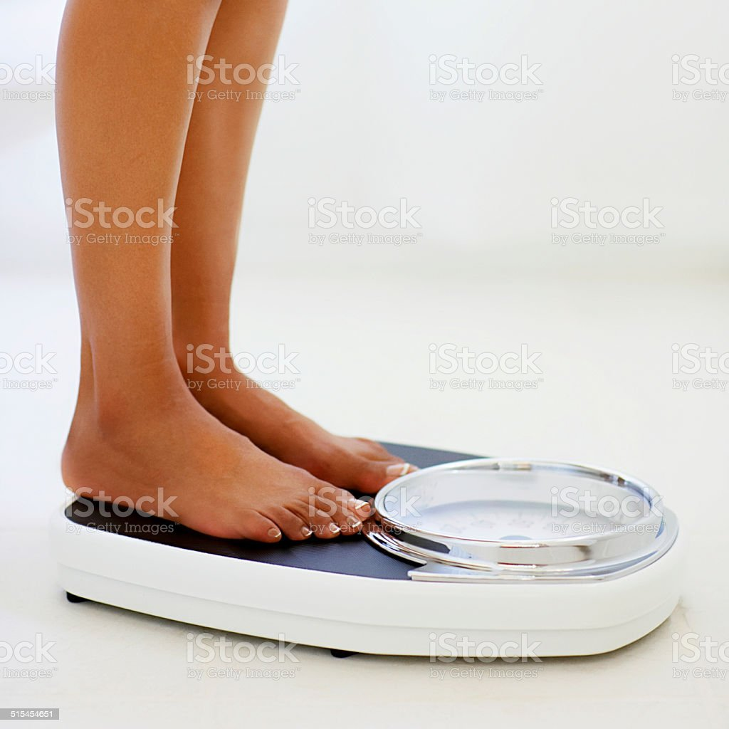Feet On Bathscale stock photo