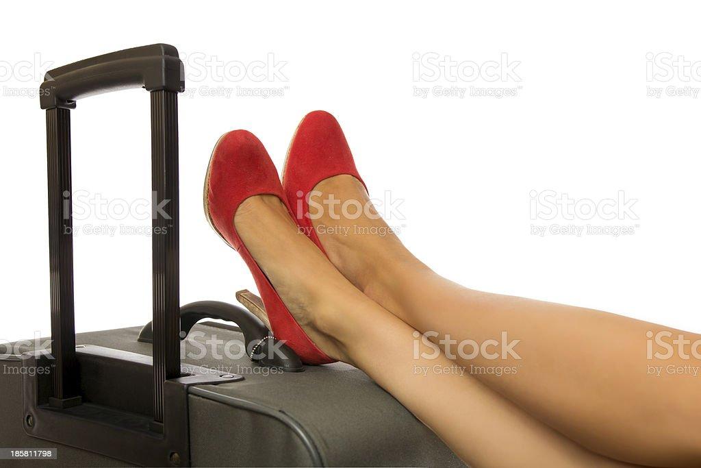 Feet on case stock photo