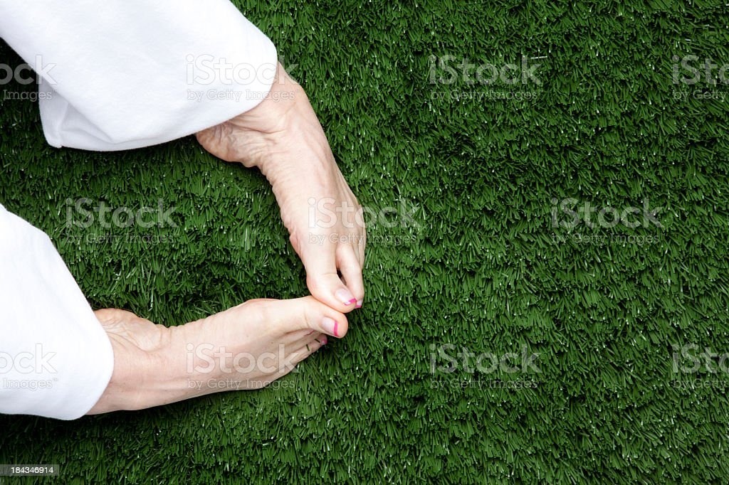 Feet On Grass stock photo