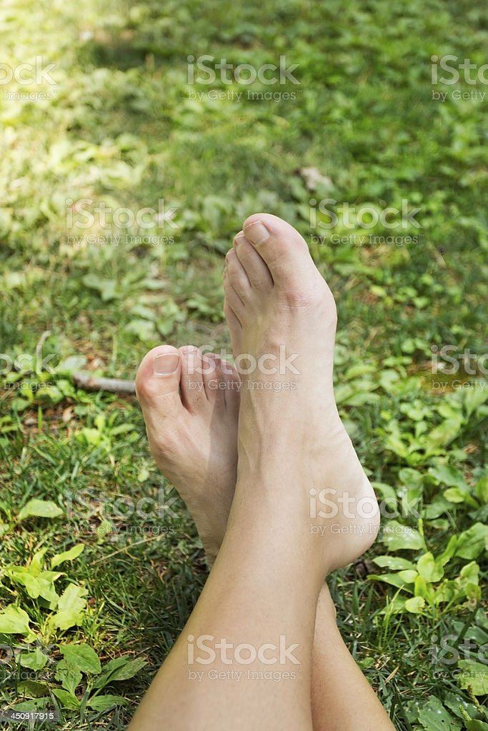 Feet on green background royalty-free stock photo