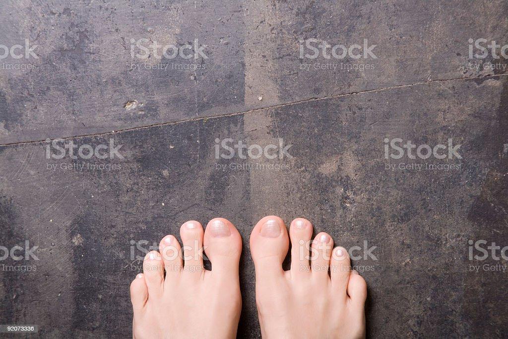 Feet on grey slate stock photo