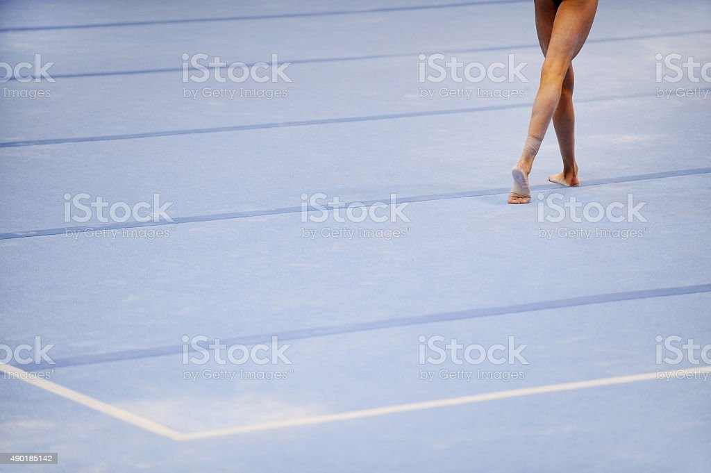 Feet on gymnastics floor stock photo