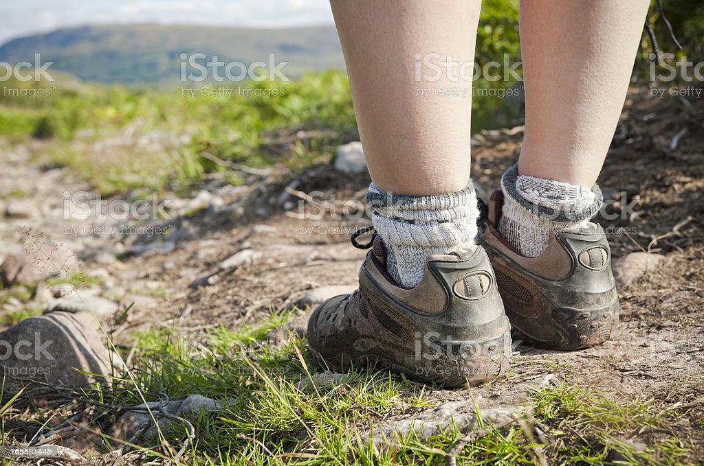 Feet on Hiking Path Close Up stock photo