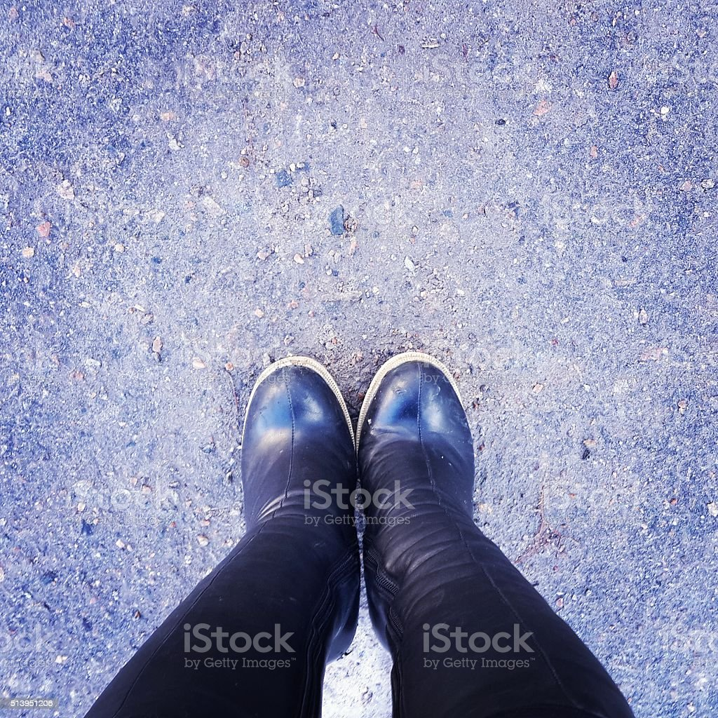 Feet on the asphalt. stock photo