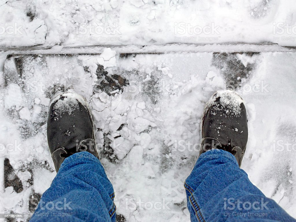 Feet on the stairs in a snow. stock photo