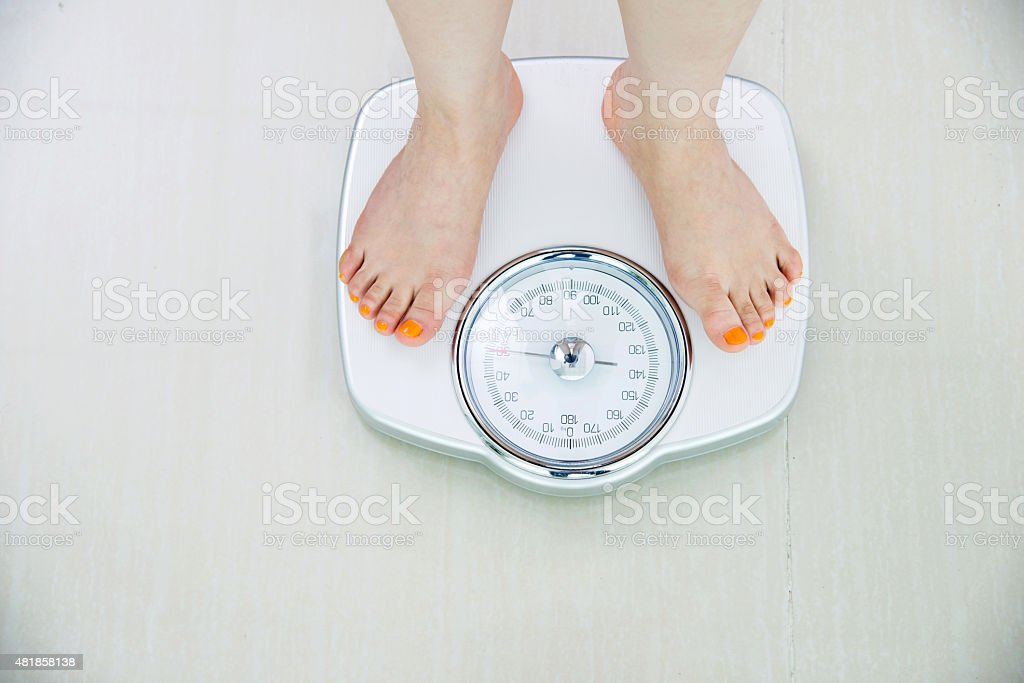 feet on weight scale stock photo