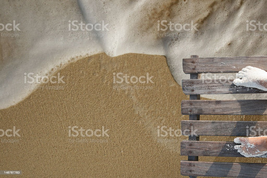 Feet on wooden palette. stock photo