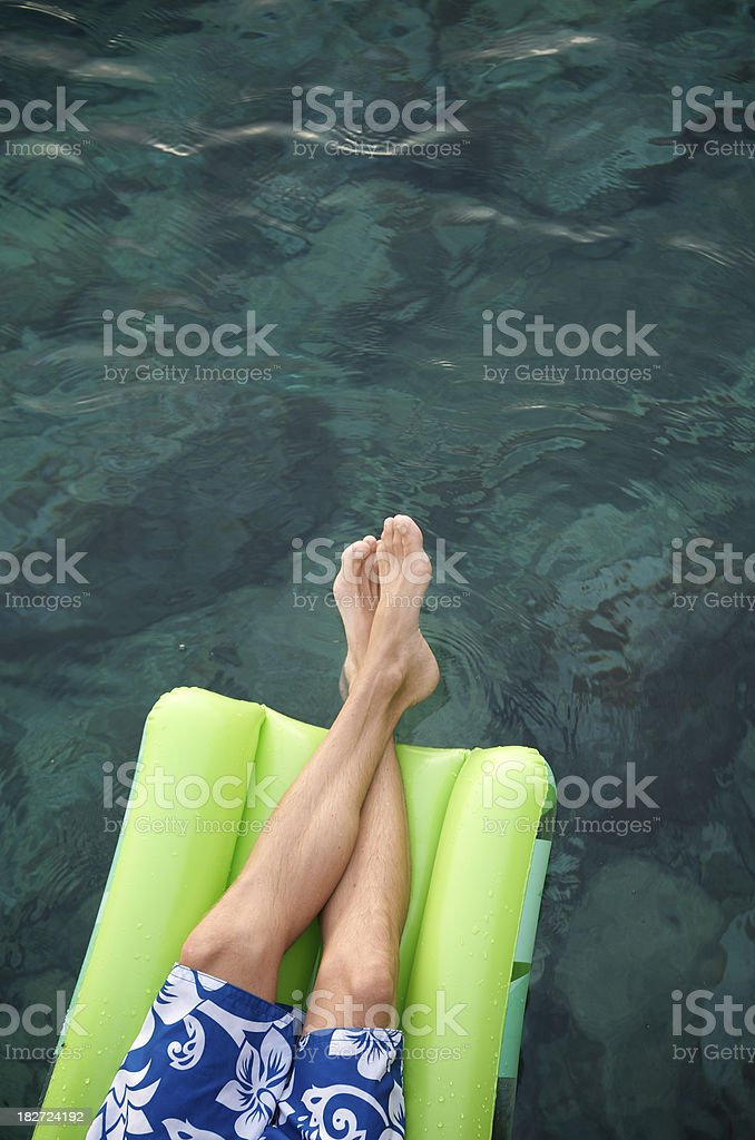 Feet Relaxing on Green Lilo royalty-free stock photo
