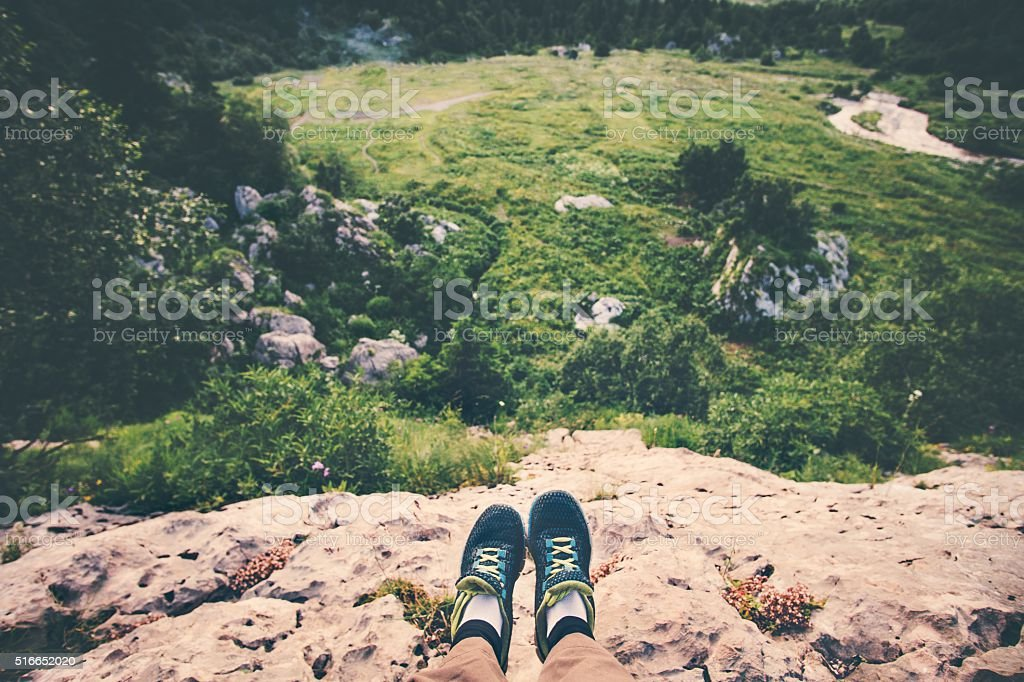 Feet Selfie running shoes Traveler relaxing on cliff mountains outdoor stock photo