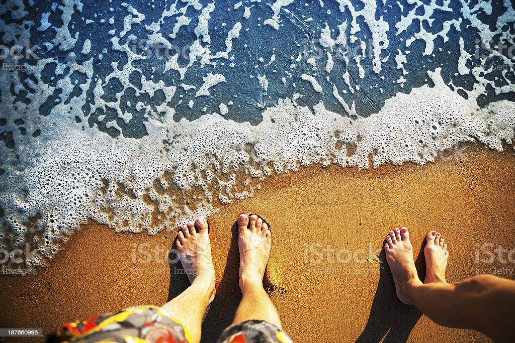 Feet standing on the beach stock photo