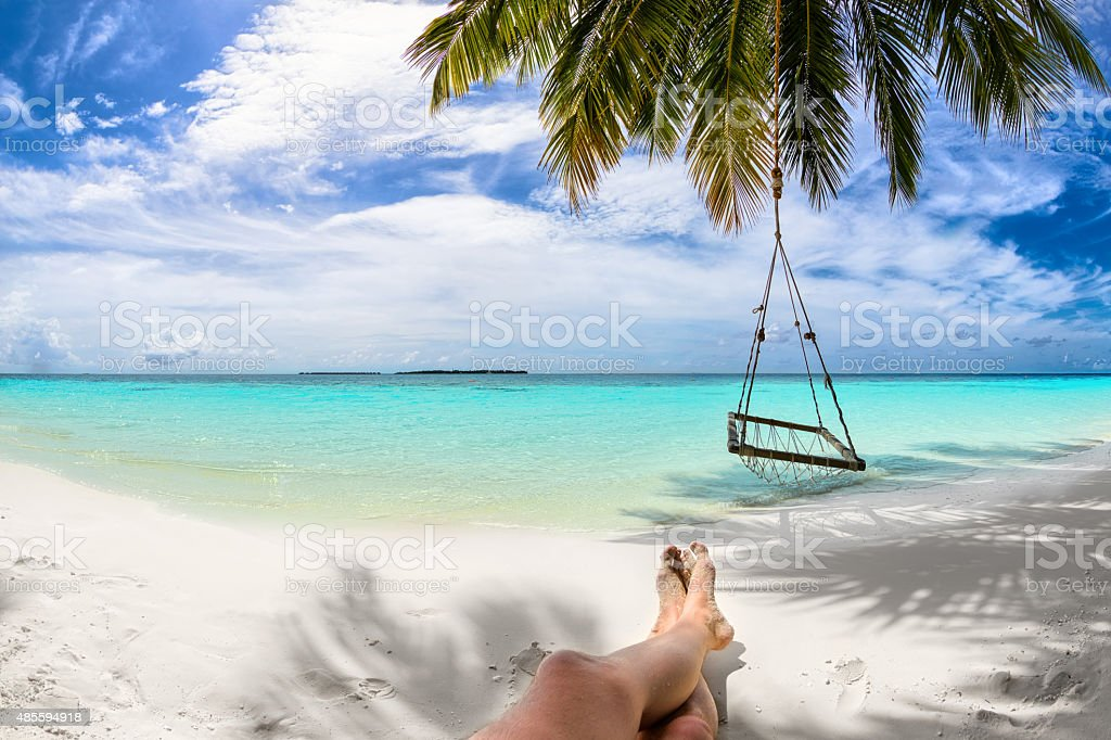 feet under coco palm stock photo