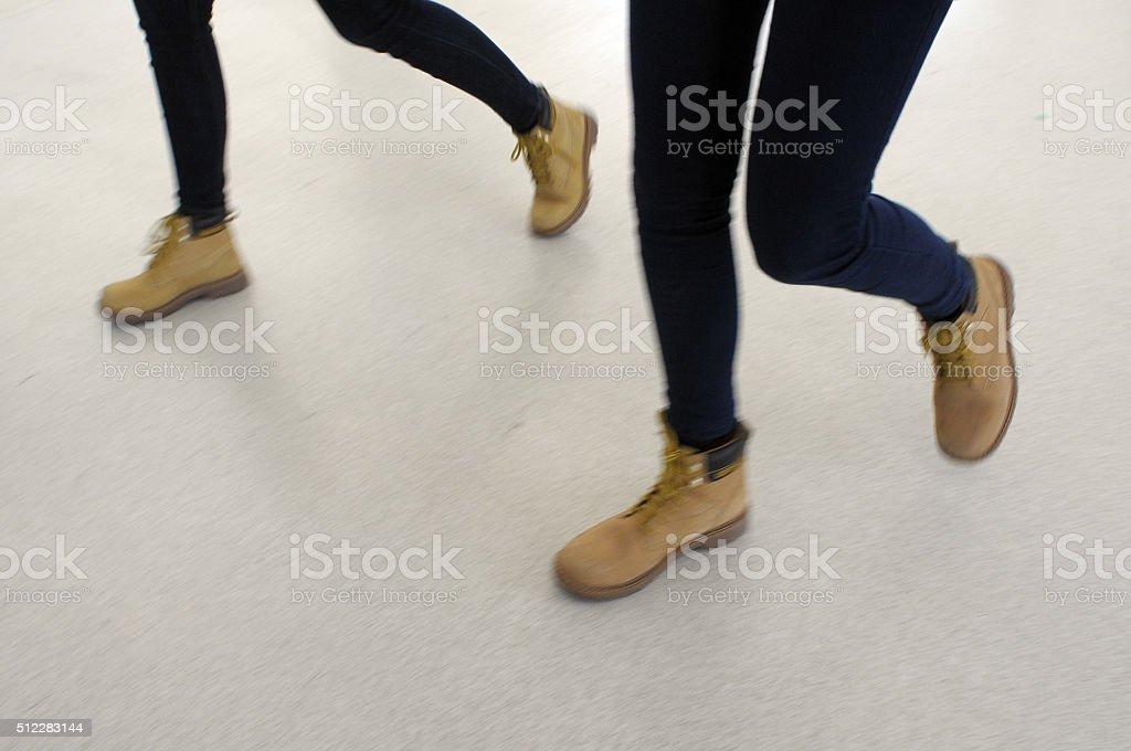 feet walking fast stock photo