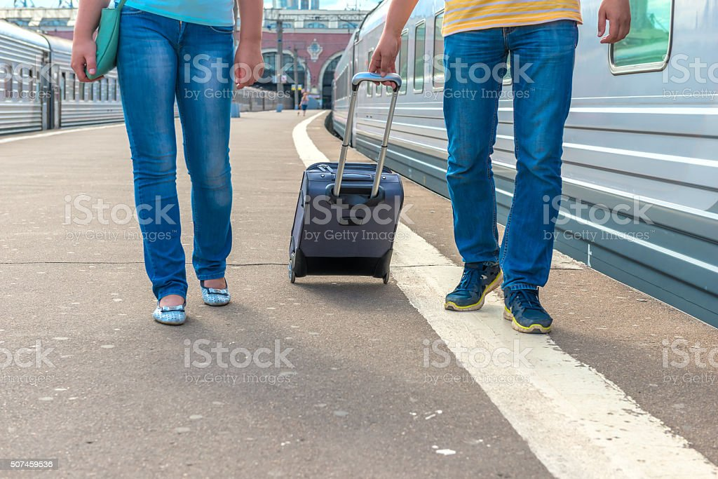 feet walking on the platform passengers with a suitcase stock photo