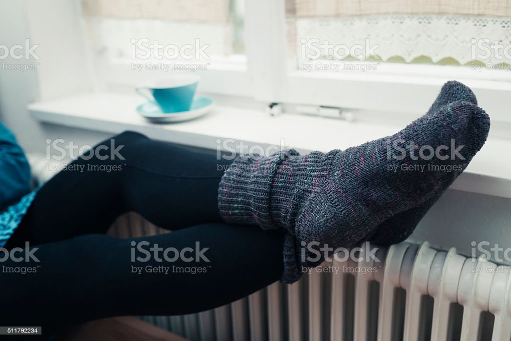 feet warming and tea time stock photo
