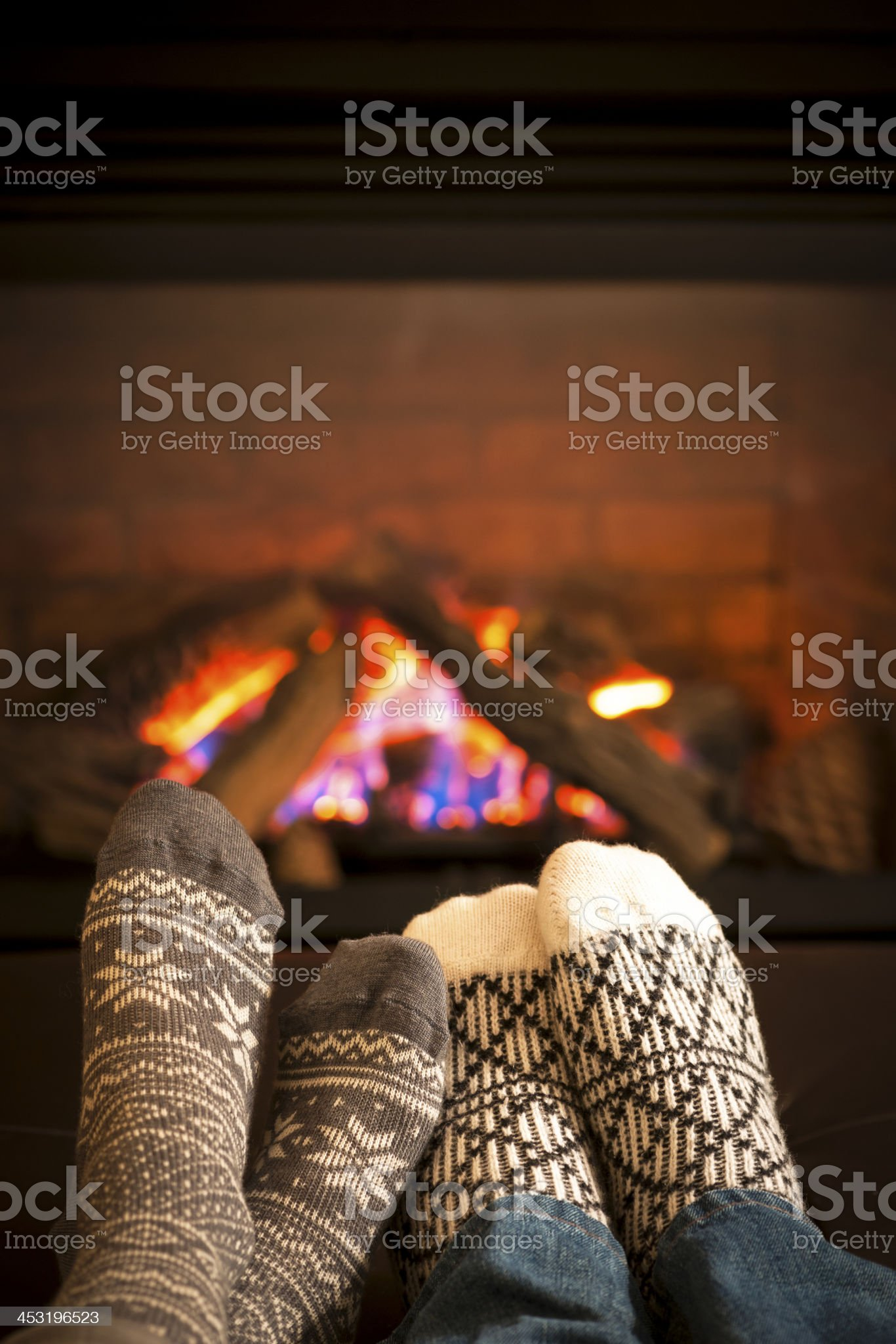 Feet warming by fireplace royalty-free stock photo