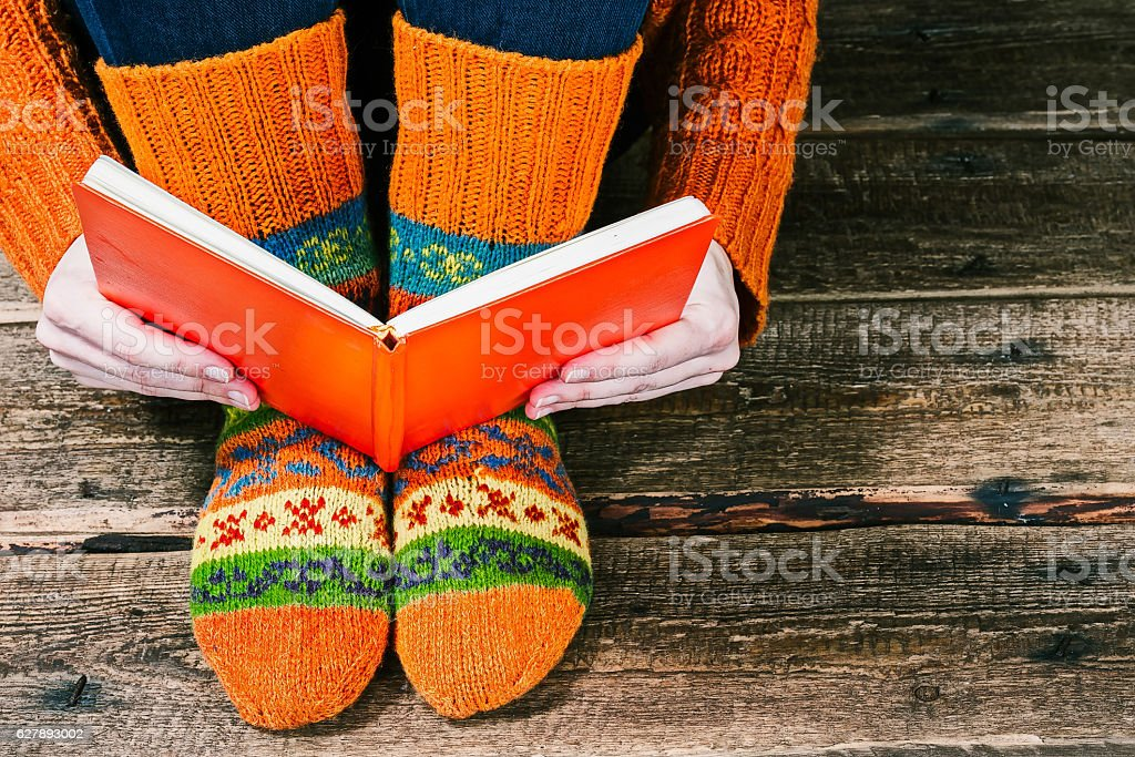 Feet with book stock photo