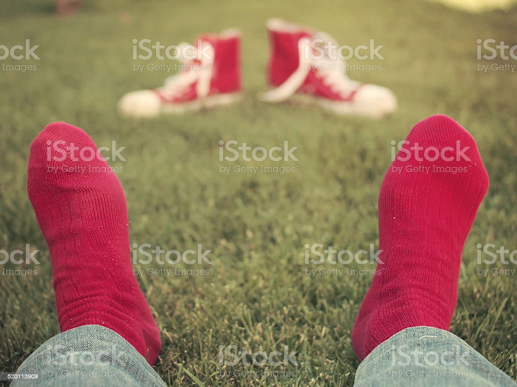 Feet with red socks stock photo