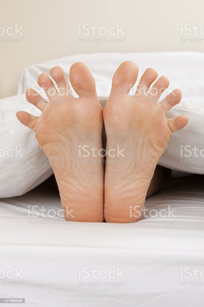 Feet with toes seperated stock photo