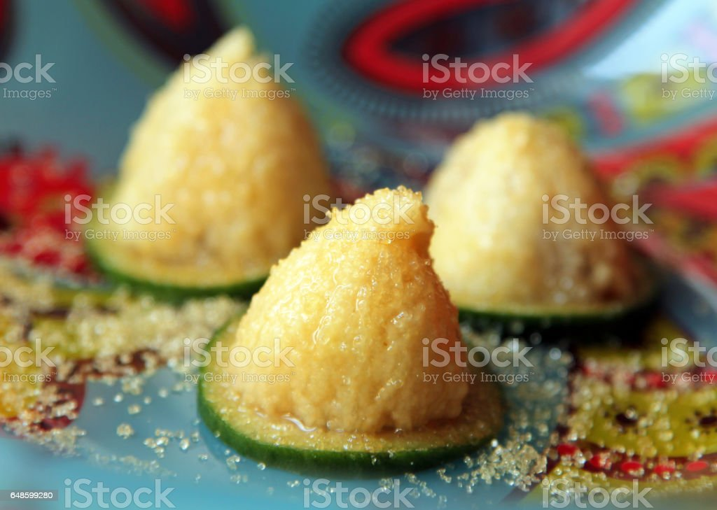 Feijoa (Acca sellowiana) pulp with brown sugar on colorful plate stock photo