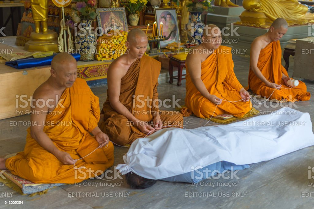 Feint requiem is a ceremony for protect to dead. Use shroud cover on a man by monk in Thai temple stock photo