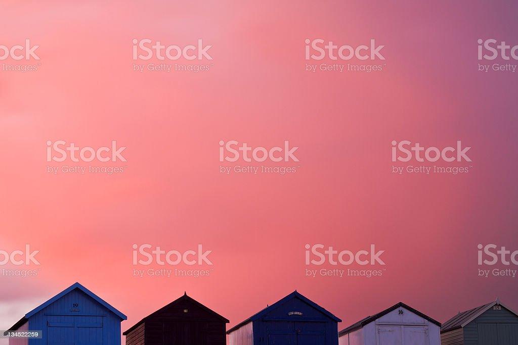 Felixstowe Fire Sky Beach Huts stock photo