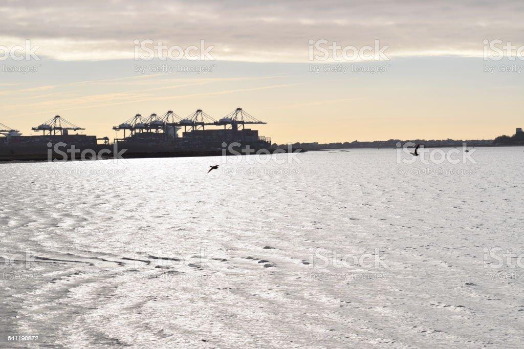 Felixstowe port side view at dusk sea stock photo